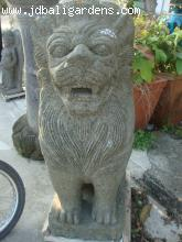 Bali temple lion-green volcanic stone